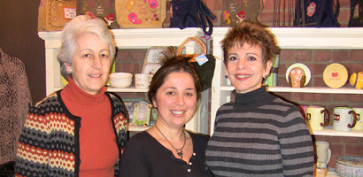 Center; Bella Stockler, owner of Bella's Boutique, left; Francesca Spinner and on right Marian Randazzo of the Neighborhood House.