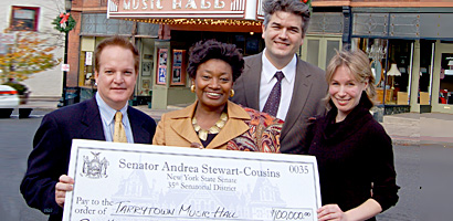 State Senator Andrea Stewart-Cousins presents a $100,000 state grant to Stephen Ballas, Music Hall Board President, Björn Olsson, Executive Director, and Karina E. Ringeisen, Theatre Manager. Photo : Maureen Fleming