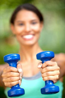Girl holding weights