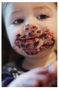 Child with chocolate on his face