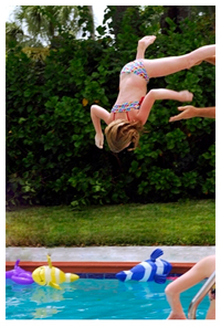 Girl jumping in pool