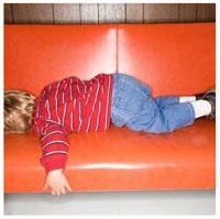 Kid sleeping on sofa