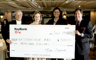 Proceeds from the 2010 Key4Women Forum and a gift from KeyBank, totaling $5,000, were donated to Westchester Arc. Pictured, left to right: Larry McNaughton, board president, Westchester Arc; Anne Sweazey, executive director, Westchester Arc; Ruth Mahoney, newly appointed president of KeyBank's Hudson Valley/Metro NY District; and Mike Orsino, retiring president of KeyBank's Hudson Valley/Metro NY District.