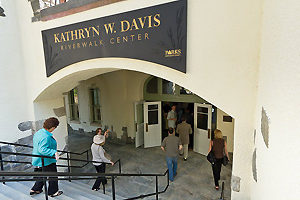 A sign marking the entry to the newly renovated Sleepy Hollow bathhouse now known as the Kathryn W. Davis RiverWalk Center.