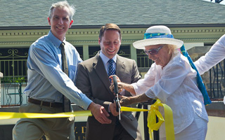 From left, Scenic Hudson President Ned Sullivan, Westchester County Executive Robert P. Astorino and Kathryn W. Davis cut a ribbon to mark completion of renovations of the historic Sleepy Hollow bathhouse now known as the Kathryn W. Davis RiverWalk Center.