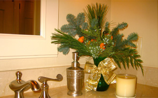Special touches like an arrangement in the powder room give your home a festive feel
