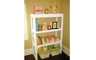 Decorative baskets and colorful boxes provide easy storage for stuffed  animals and other toys in the nursery.