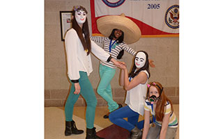 (L-R) Rebecca Strauss, Komal Keerthy, Olivia Banc and Kylie Elwood act out a scene from their award-winning Destination Imagination mime presentation.
