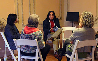Yibing Huang (Mai Mang) reads to a small group in last year's line of up international poets. Also pictured are Lynn Francis and Floyd Cheung.