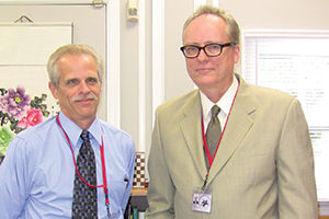 John Staiger, Jr., Asst. Supt. of Business Christopher Clouet, Superintendent