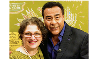 Owner Lisa Globenfelt and Host John Quinones