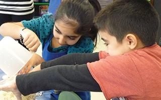 Second graders create popcorn at Todd Elementary School.