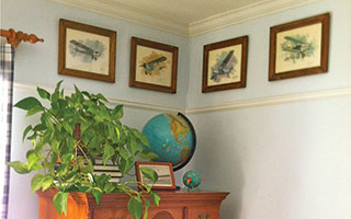 This collection of airplane prints in a young boy's bedroom was highlighted by adding a thin piece of architectural molding just below the prints. The photos and molding both continue around the entire room.