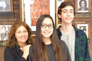BHS visual arts coordinator and teacher Roxanne Ritacco congratulates BHS sophomore Maya Ponzini and junior David Kaminsky on being awarded Scholastic's Art and Writing Regional Gold Key Awards for their oil painting.