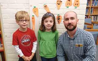 Todd School Kindergarteners  Ryder Ludwig, Caroline Pastore,  and author Peter Brown.