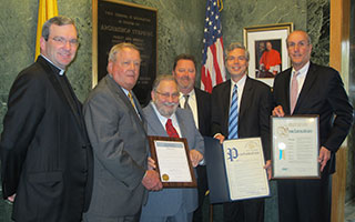 From left, Father Thomas Collins, President of Stepinac High School; William F. Plunkett, Chairman of the Board; Ron Tedesco, honoree; Paul Carty, Principal; Thomas Roach, Mayor of White Plains; Kevin Plunkett, Deputy County Executive. Tedesco was presented with proclamations from Tarrytown, White Plains and Westchester County for his remarkable milestone.