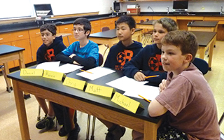 Pictured from left are Briarcliff Middle School sixth-graders Daniel de Castro, Kevin Mani, Chris Li, Matthew Sturman and Michael Donoghue participating in a Pace University STEM-D conference via Skype.