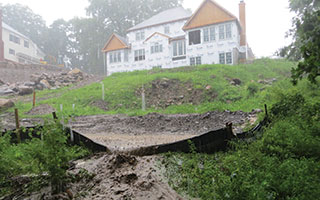 Mud breaching the silt fence on Lot 7 of the Wilson Park development  and heading to the Tarrytown Lakes.