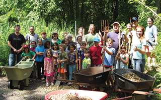 Volunteers worked tirelessly to prepare Peabody Preserve Outdoor Classroom for its grand opening.