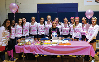 "The Briarcliff varsity volleyball team hosted a ""pink"" game in October and held a bake sale to raise money  for the American Cancer Society's breast cancer research."