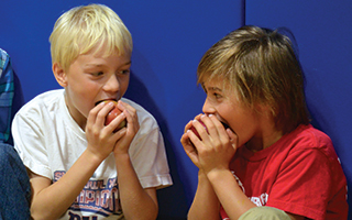 Kindergarteners enjoy their apples during Todd Elementary School's  Big Apple Crunch.