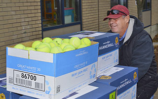 3,000 used tennis balls donated by the U.S. Tennis Association's Employee Green Committee in White Plains will be used for the bottom of chairs throughout the Irvington School District.