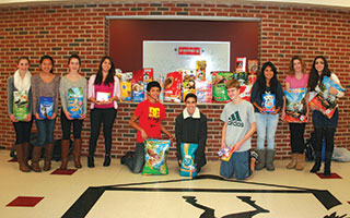 Sleepy Hollow High School  students  celebrate  a successful pet food drive.