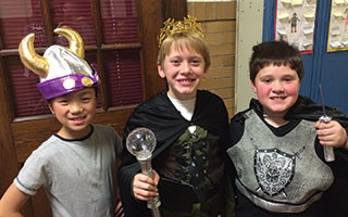 Washington Irving students Cynthia Cai, Cooper Taylor, and Carver Lis dressed up for Shakespeare Night.