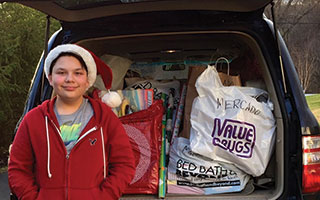 Briarcliff High School student Andrew Sugrue with the gifts he collected for Neighbors Link.