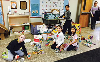 "Dows Lane students sort donations to a local animal shelter  as part of December's celebration of ""Dows Day."""