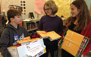 Irvington Middle School students collect packages to send to troops overseas.