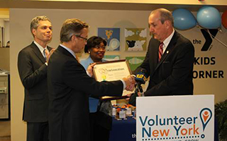 Mark Rollins, Volunteer New York! Board Chair, receives proclamation from Deputy County Executive, Kevin Plunkett, while White Plains Mayor Tom Roach and Senator Andrea Stewart-Cousins watch on.  Photo Credit: Volunteer New York!