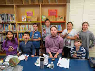"Seven Todd Elementary School fourth- and fifth-grade students' award-winning essays earned them an opportunity to have lunch with Adam Gidwitz, author of a ""Grimm"" book series."