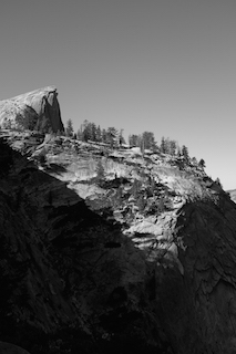 The peak of Half Dome appears in the distance  during the final portion of an 8-mile ascent.