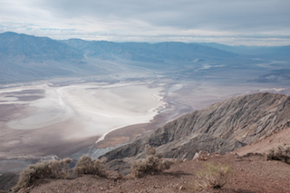 The barren and chilling expanse of  California's Death Valley unfurls into the distance.