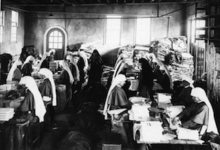 Production of The Field Afar magazine on Maryknoll's Ossining property during 1929. The magazine now is known as Maryknoll magazine.