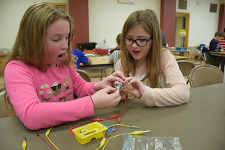 Dows Lane Elementary School students Keira Ruffler and Chloe Macessey were amazed by the All Charged Up Electricity program, part of an interactive Mad Month of Science learning unit funded by the Irvington Education Foundation.