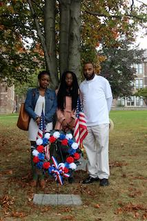 Shayla Wyche, Craig Wyche's cousin; niece Kijafa Alston; and brother Glenn Wyche stand by the tree and memorial plaque at Ossining High School
