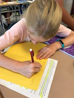 Anne M. Dorner Middle School sixth-grader Emma Stein writes a letter to an active-duty service member on 9/11.