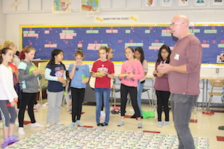 Game designer David L. Hoyt demonstrated the power of words to a group of sixth graders at Sleepy Hollow Middle School.
