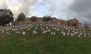 Drivers on Route 9 could see the 420 flags honoring Veterans adorning the Middle/High School's front lawn.