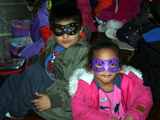 Kindergarteners Matthew Paute and Nayeli Ovalle donned masks and enjoyed the Super Readers' onstage antics.