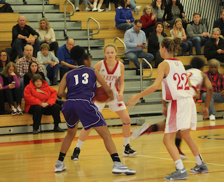 Sara Laub and Sophia Meyer go on the defense against the Lincoln Lancers at the Howard Godwin Holiday Basketball Tournament.