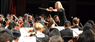 Brittney Trenczer conducts the Sleepy Hollow Middle School Orchestra at the Winter Concert.