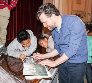 Author and illustrator Mark Siegel meets with young authors after his presentation at Washington Irving School.