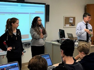 BHS students Emilie Mazzola and Emily Sam-Zee-Moi delved into the Hour of Code with J.P. Fasano, BHS mathematics and computer science teacher.
