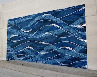 Clancy Designs Glass Studio from Jamestown, Rhode Island created the mural especially for this Hudson River location.