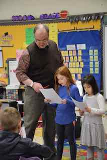 Theater educator Peter Royston teaches Dows Lane Elementary School second-graders how to tell a story in Bringing Literature to Life.