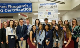Sleepy Hollow High School students explain their science research projects to a panel of judges at WESEF.