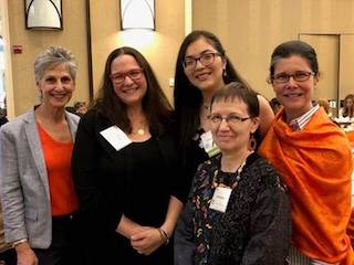 Valentina Loaiza, center, winner of the Alison Greene Scholarship, with Greene's daughter Carrie Teicher, second left, director of medical and operational research at Doctors without Borders, and from left, Westchester Women's Agenda members Alisa Kesten, Jon Wegienek and Noelle Damico.